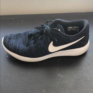 Navy nike athletic shoes.